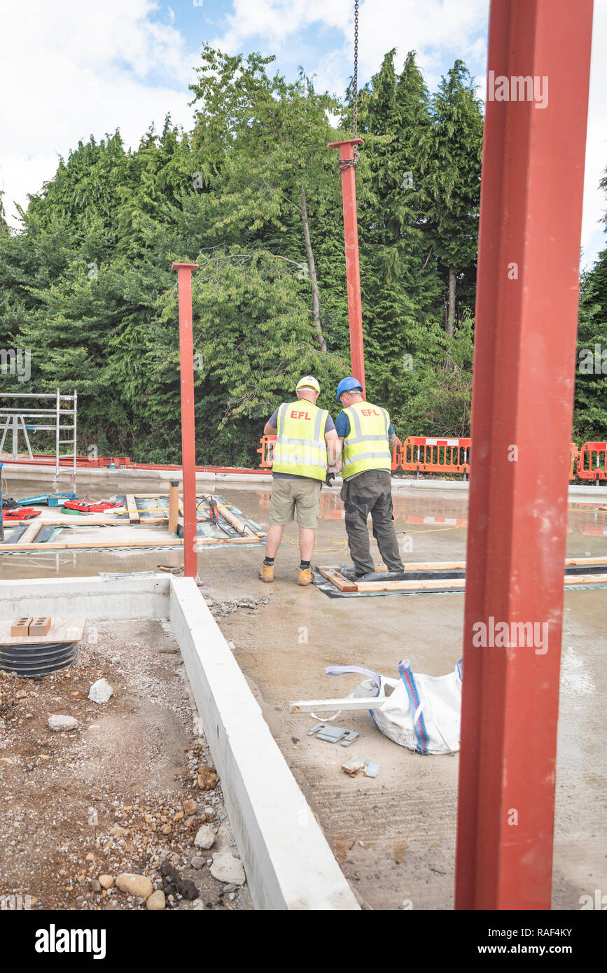Erecting steelwork on the new Maggies Cancer Centre Cardiff. Credit: Phillip Roberts - Stock Image