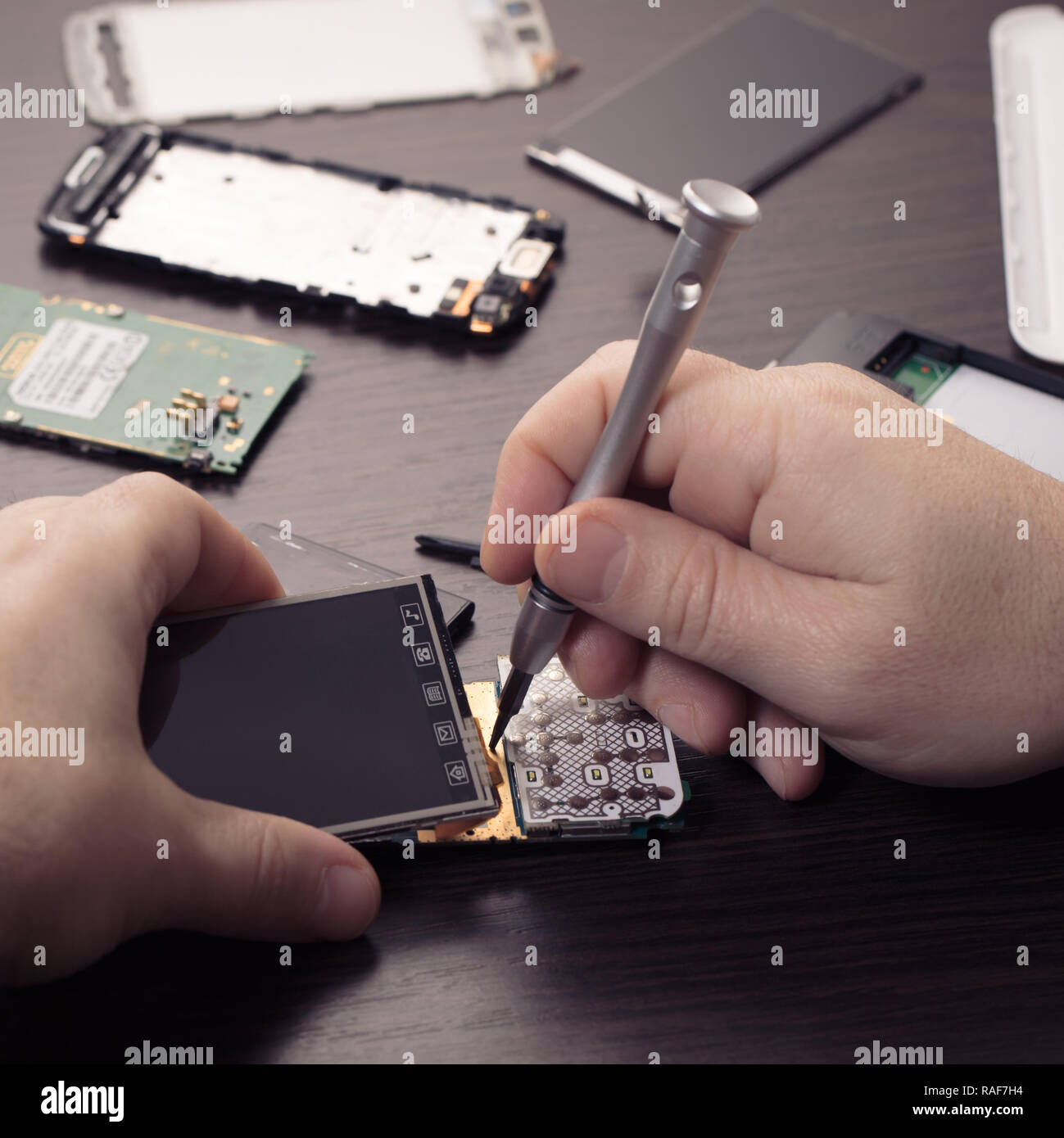 Mobile Phone Repair Hands Closeup On A Wooden Table Stock Photo Alamy
