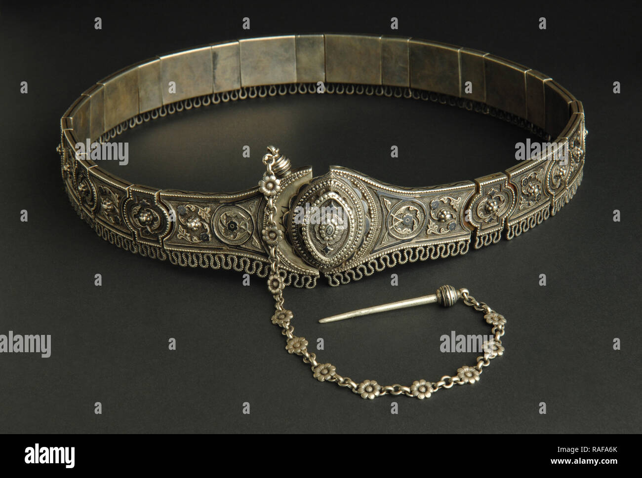ancient antique belt on black background. Middle-Asian vintage jewelry - Stock Image