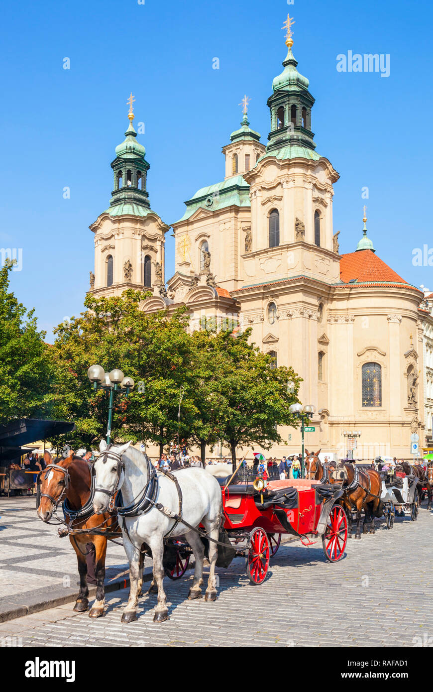 Prague St Nicholas church Prague and carriage rides from the Old town square Staroměstské náměstí Prague Czech Republic Europe - Stock Image