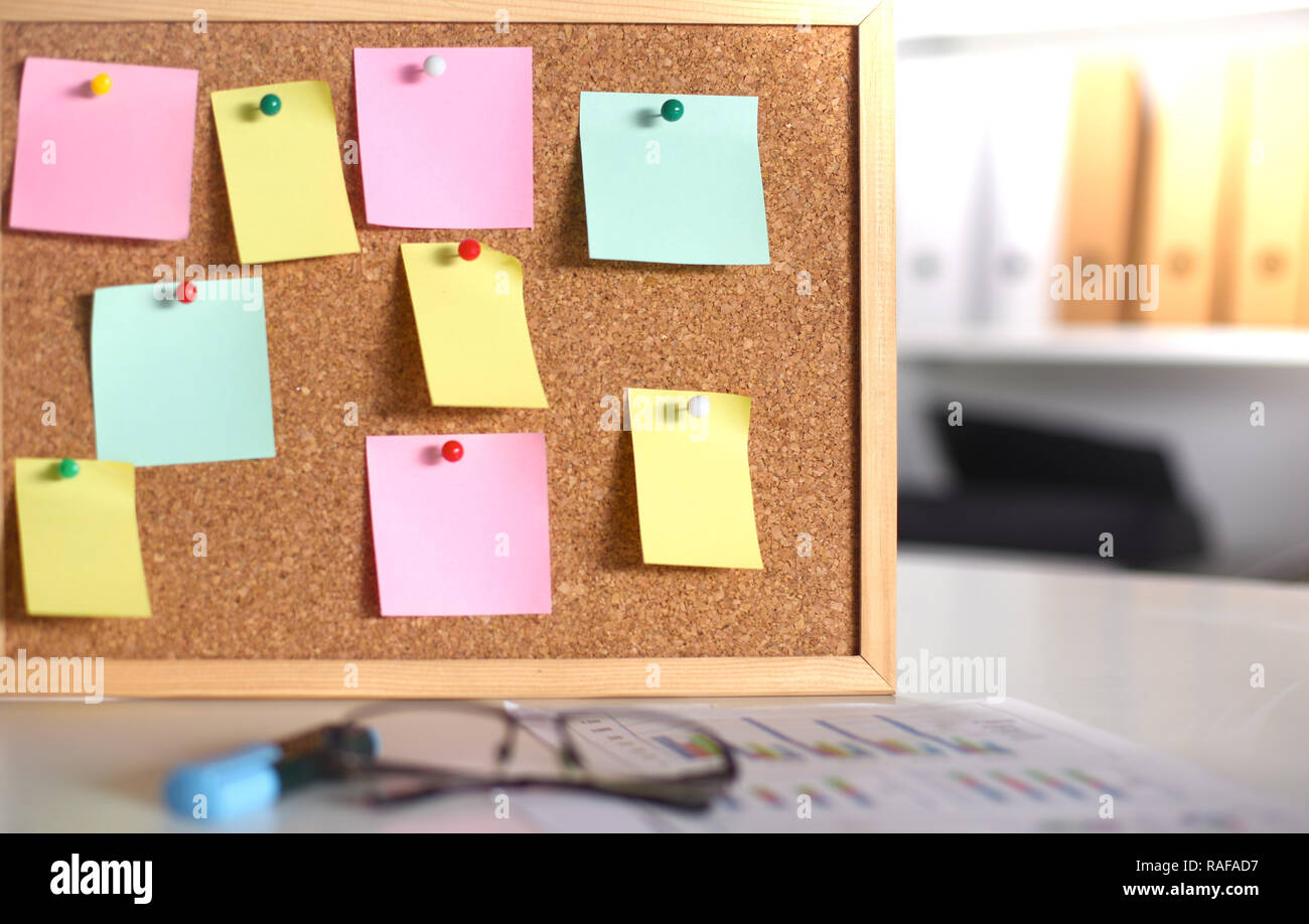 multicolored stickers on the board in the office. - Stock Image