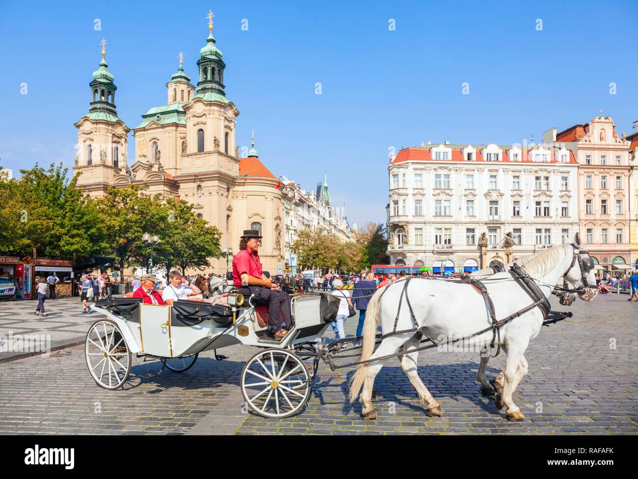 Prague St Nicholas church Prague horse and carriage rides from the Old town square Staroměstské náměstí Prague Czech Republic Europe - Stock Image