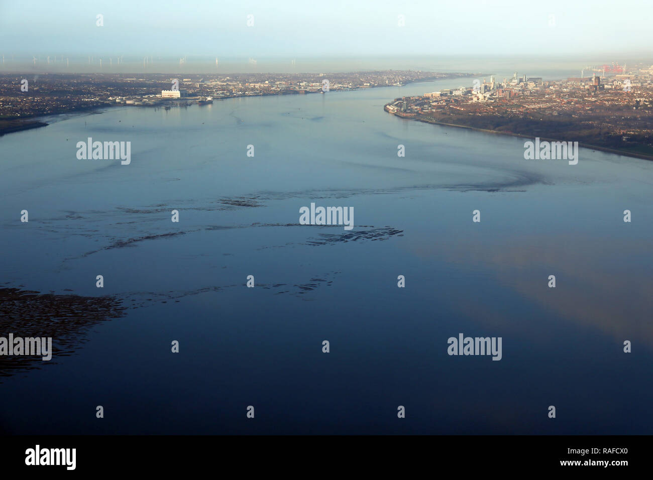 aerial view looking north over the River Mersey Estuary towards Liverpool & Birkenhead - Stock Image