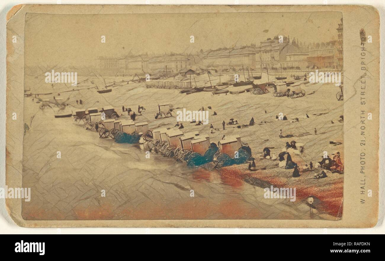 Beach scene showing bathing cabinets at shoreline, Brighton, England, W. Hall (British, active 1865 - 1890), about reimagined Stock Photo