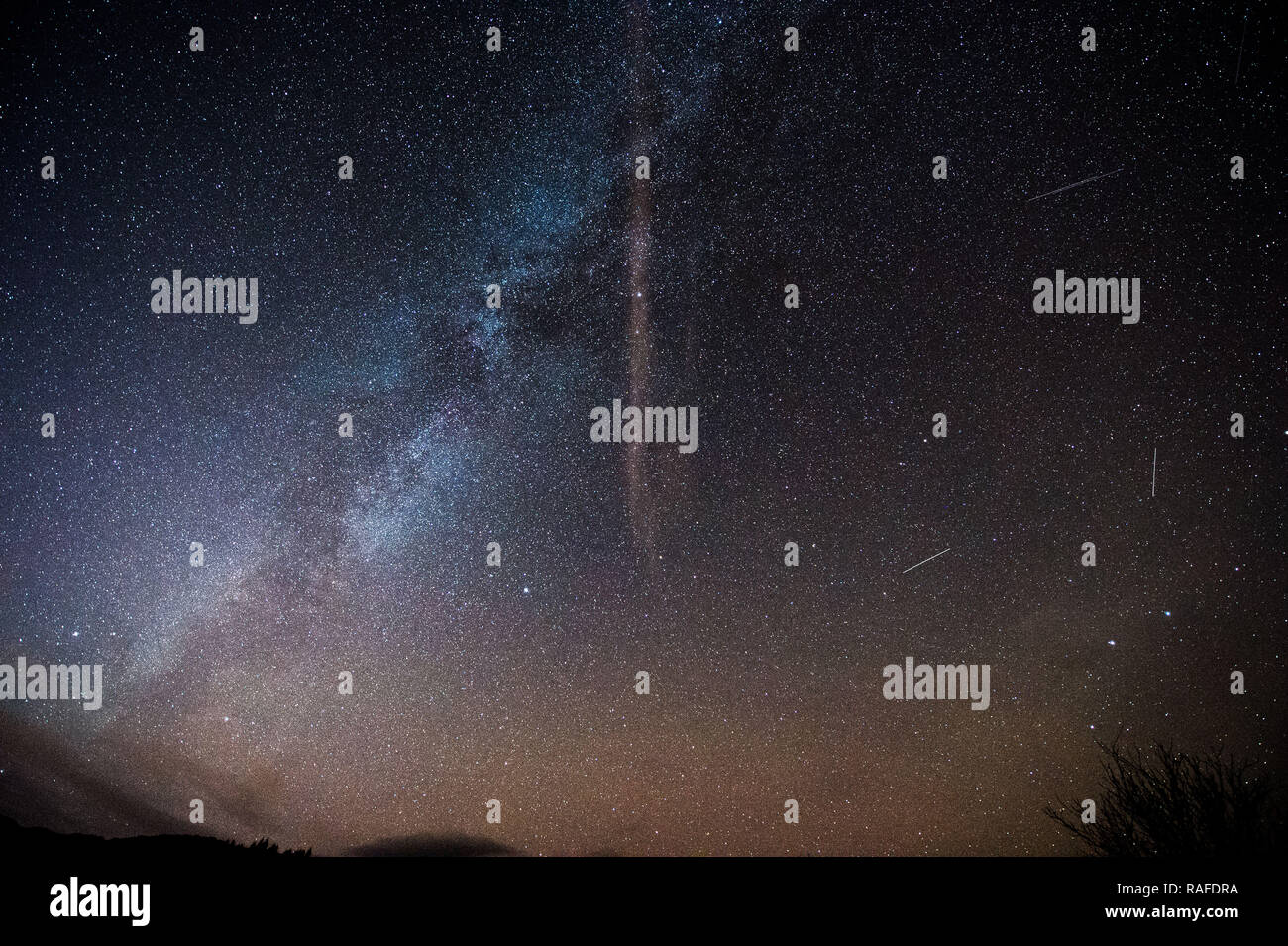 Milky Way, stars and night sky as seen from the outstanding beautiful area of The Trossachs in Scotland, Stirling, UK - 1st January 2019. - Stock Image