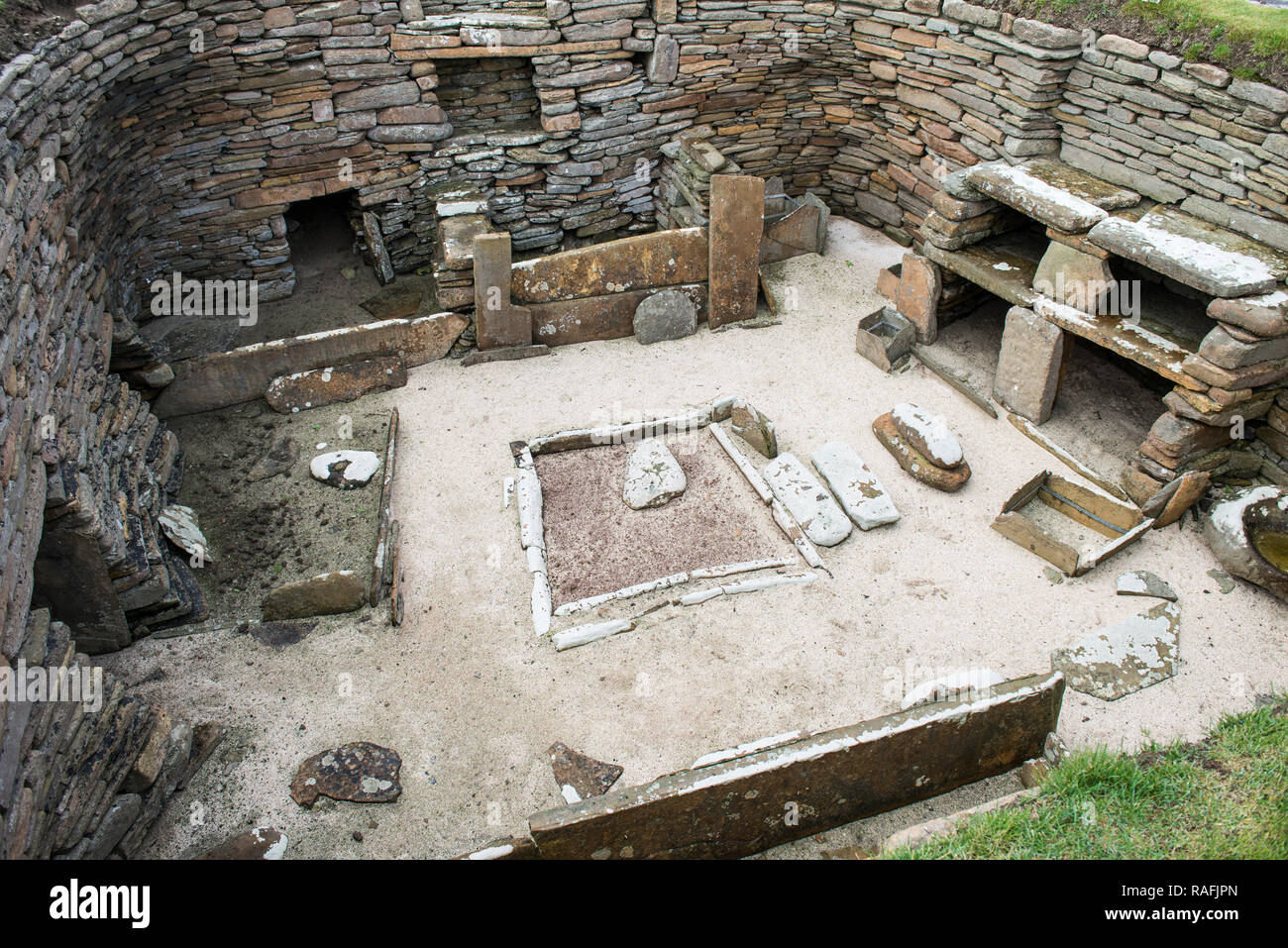 Remains of one of the homes at Skara Brae, a stone-built Neolithic village on the west coast of the Orkney Islands in Scotland Stock Photo