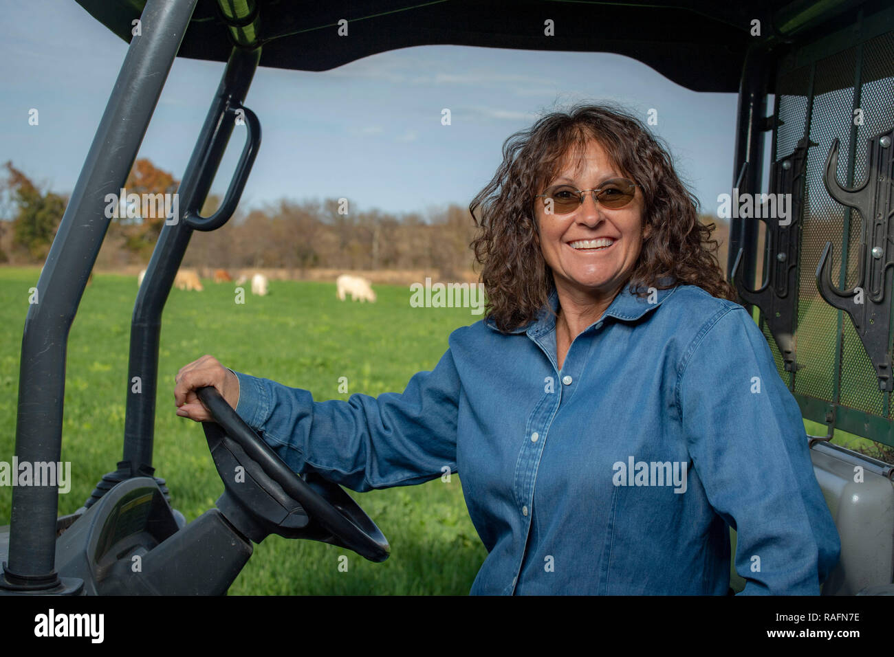 Tammy Higgins, a multi-generational Native American rancher who raises 80 head of cattle on her farm in of Okfuskee County, Oklahoma. - Stock Image