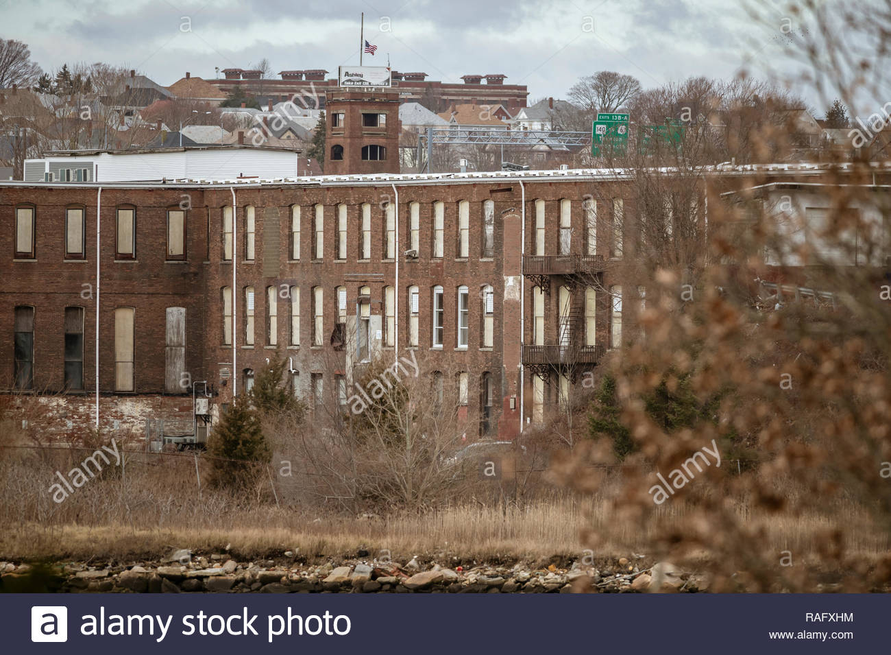 New Bedford, Massachusetts, USA - January 1, 2019: Decrepit factory along New Bedford waterfront north of Fairhaven Bridge - Stock Image