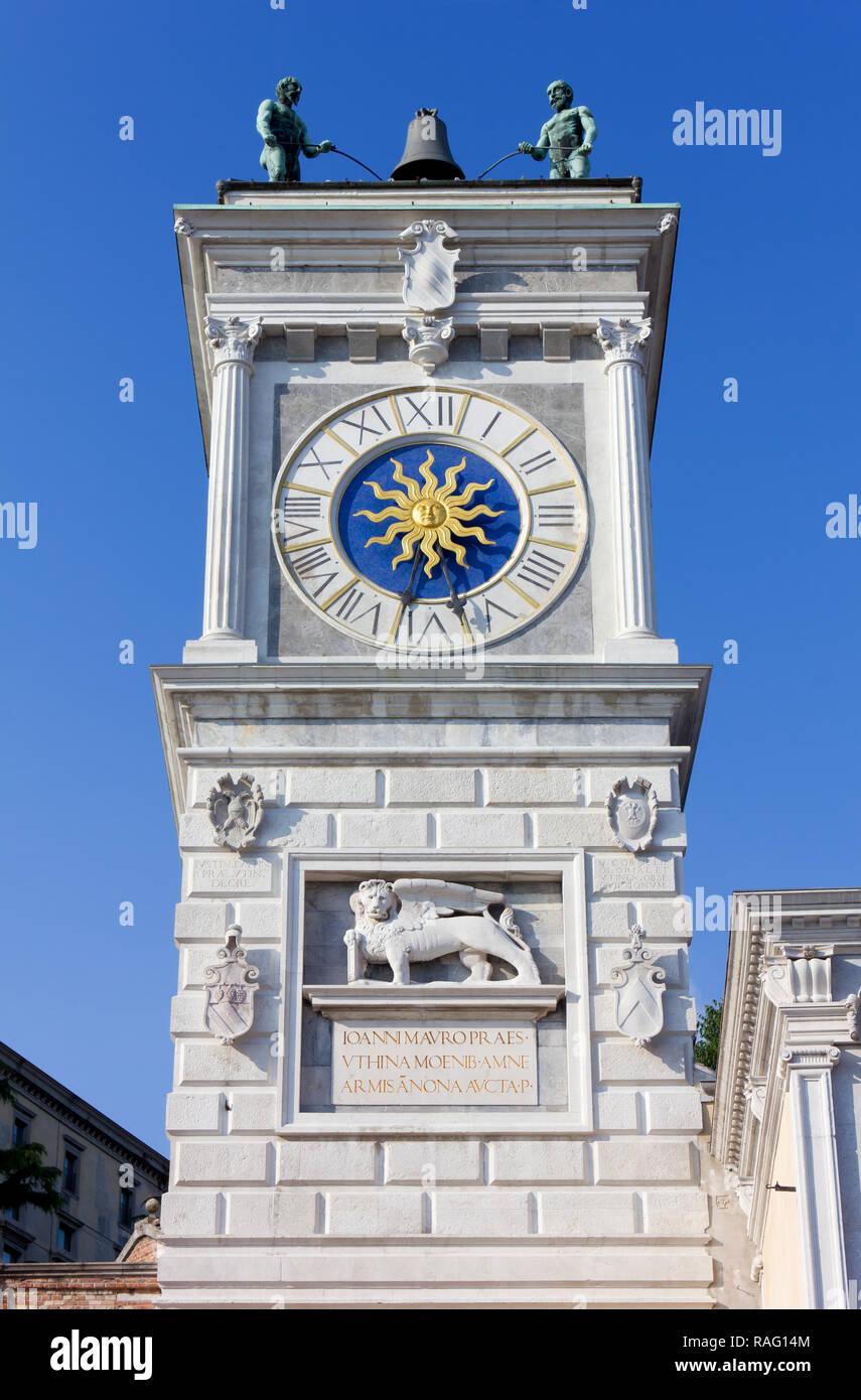 Clock tower in Libertà square in Udine, Italy - Stock Image