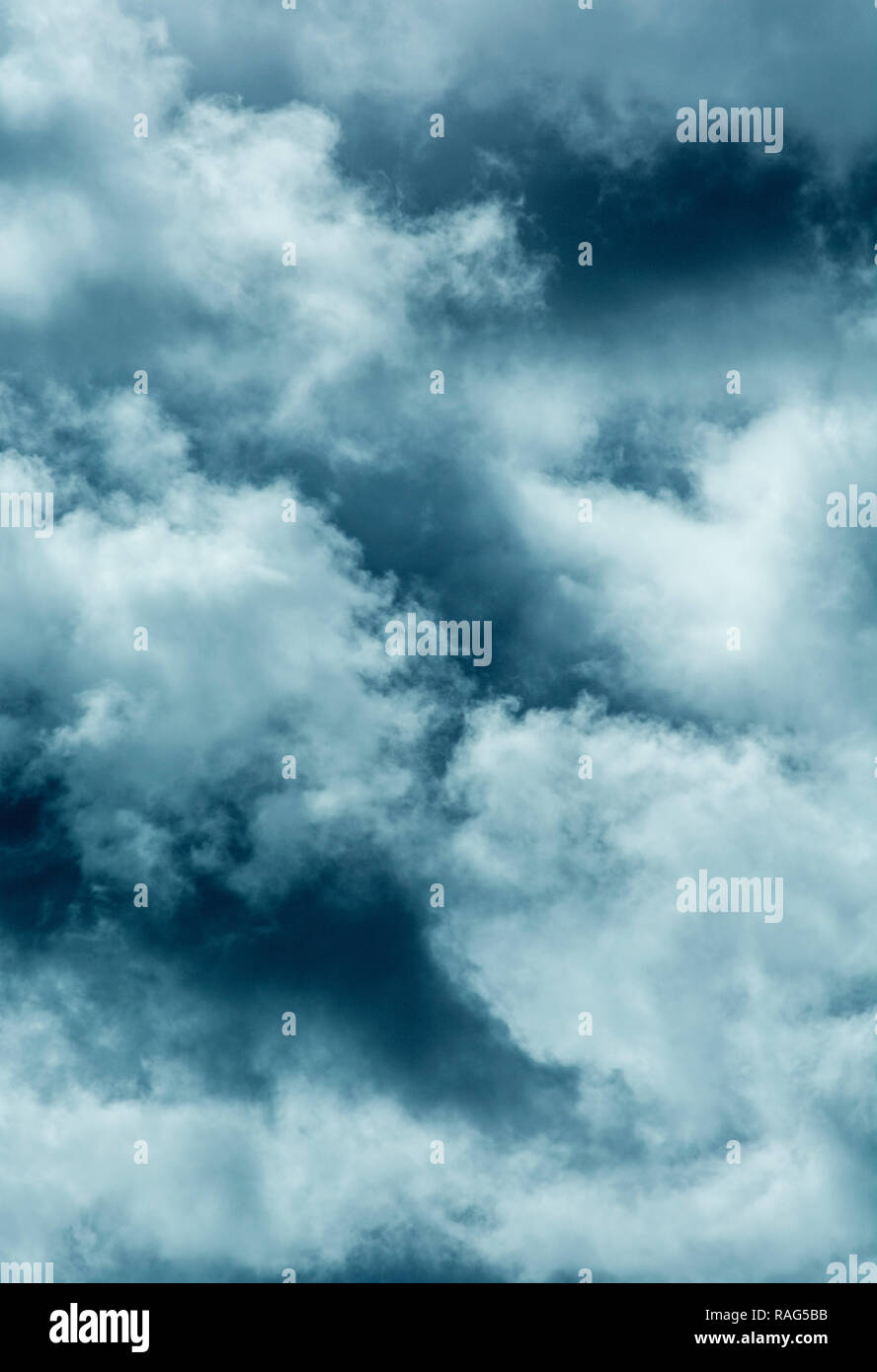 Stylised brooding and dark cloud formations (C/T digitally altered to produce green blue effect). Metaphor economic clouds, clouds on the horizon. - Stock Image