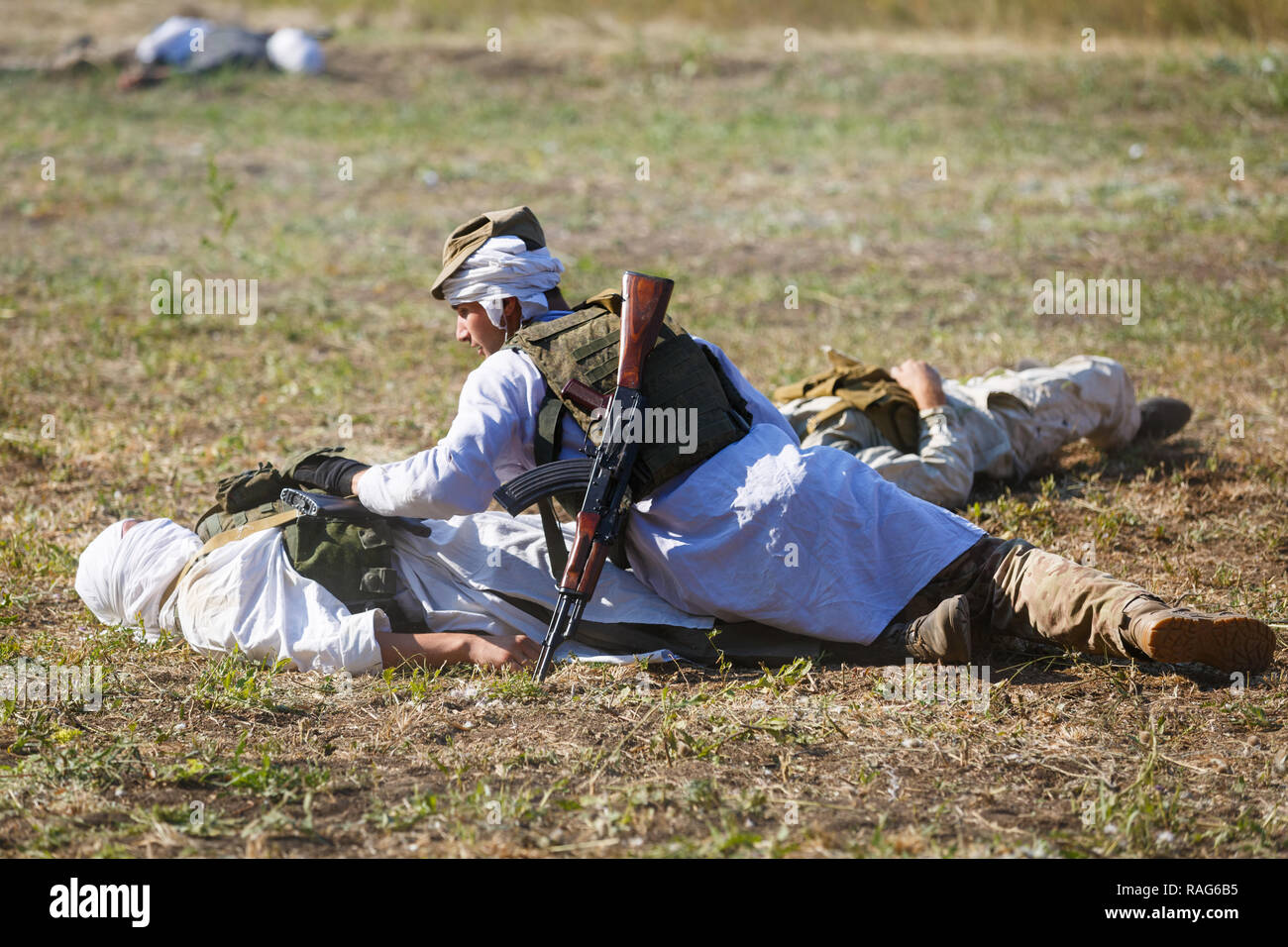 Historical festival Sambek Heights. Mujahid lean over a dead soldier - Stock Image