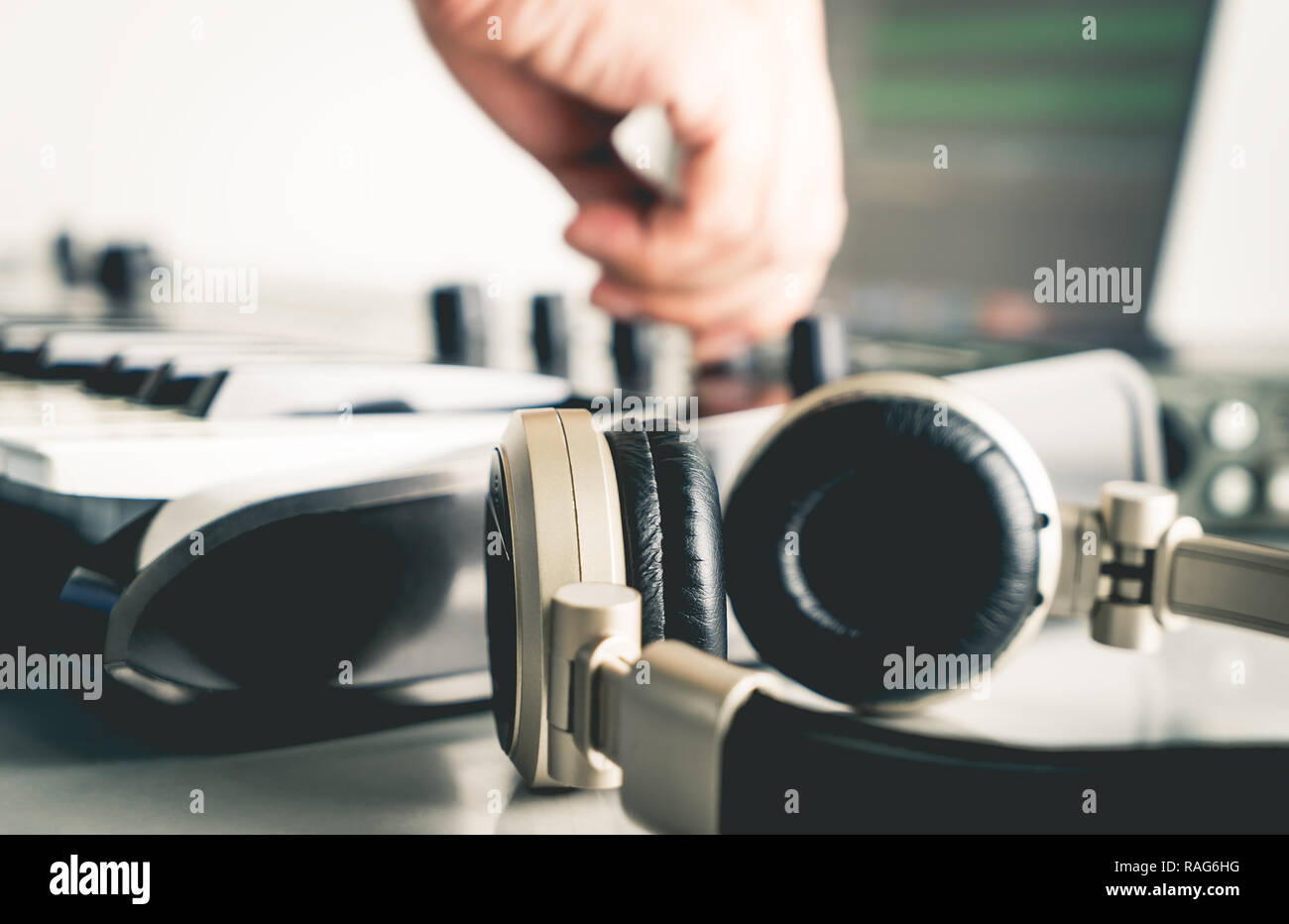 Musician is mixing and adjusting track on Portable Computer Music Studio home set up - Stock Image