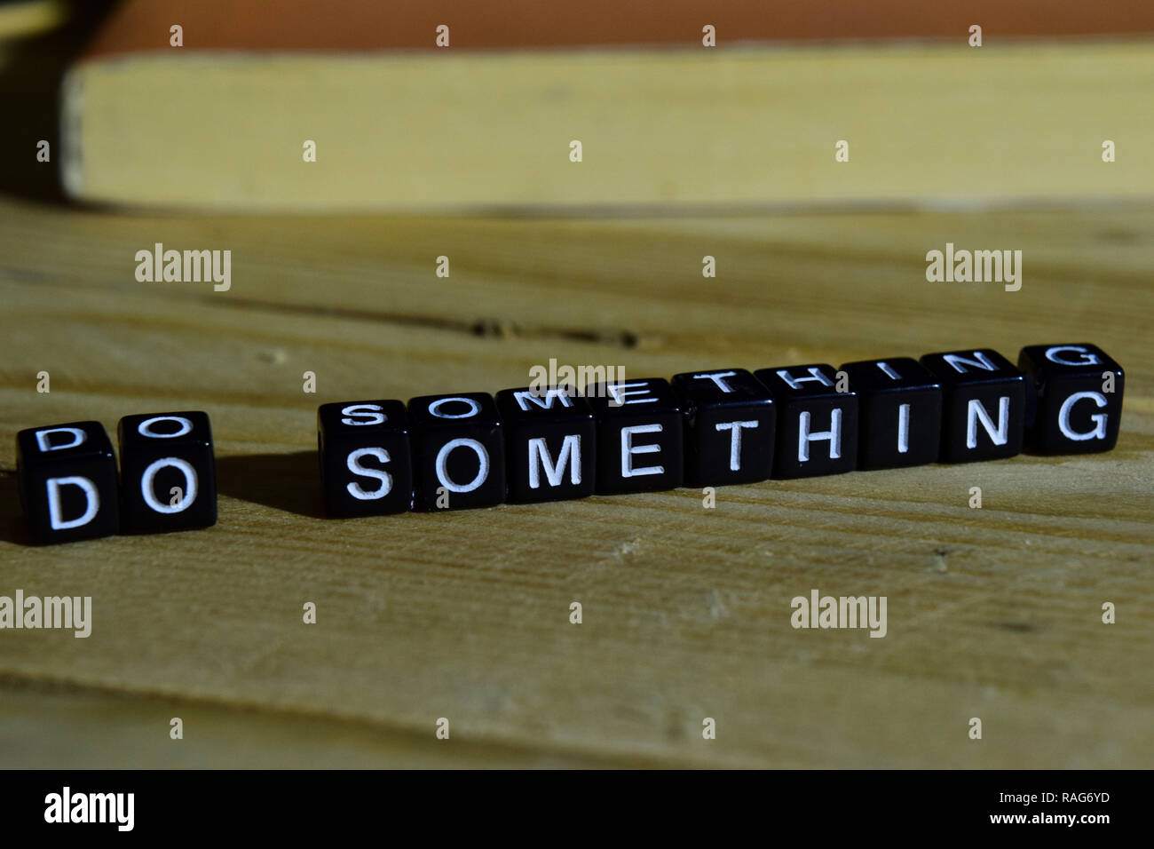 Do something on wooden blocks. Motivation and inspiration concept. Cross processed image - Stock Image