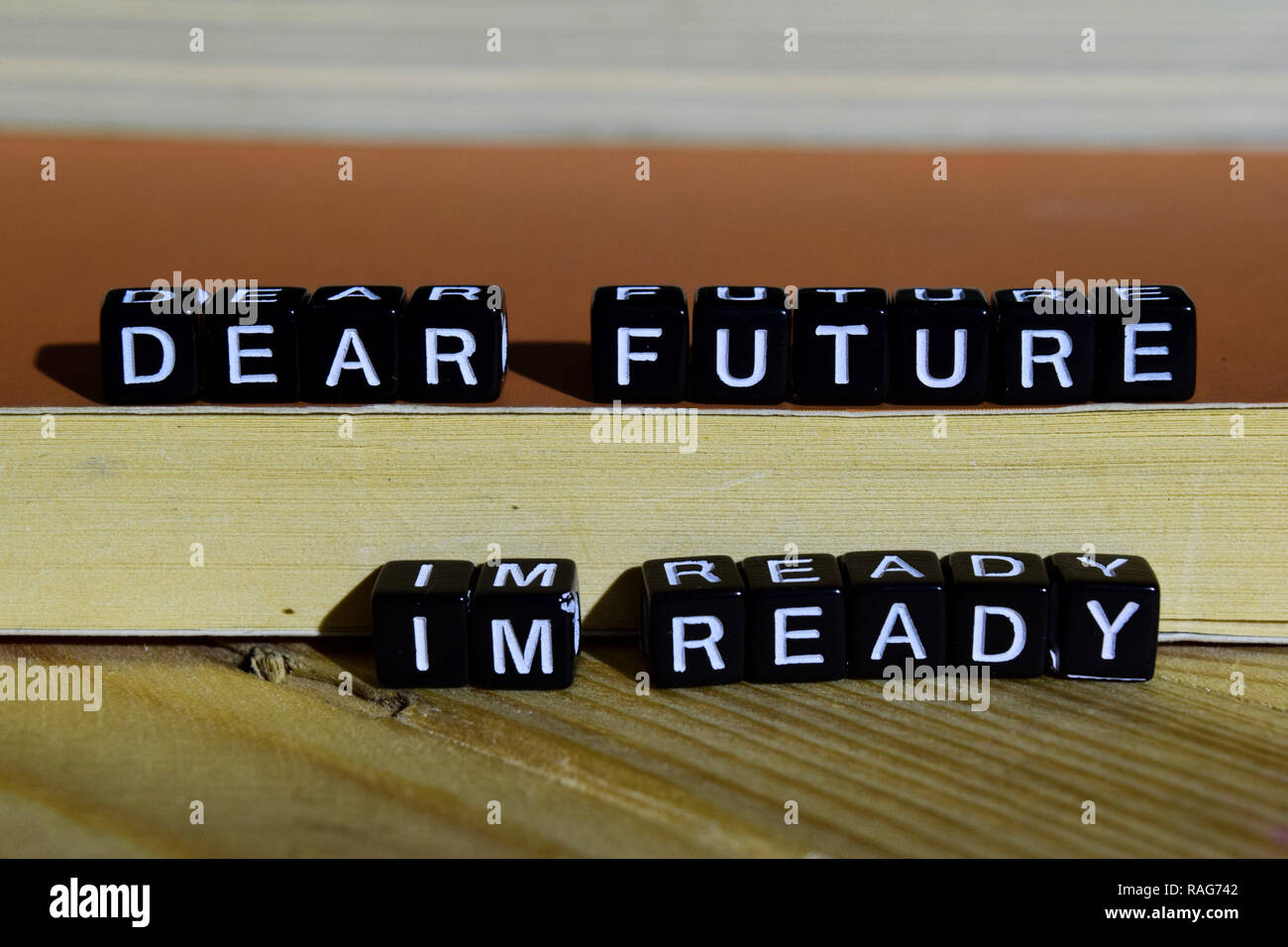 Dear future I'm ready on wooden blocks. Motivation and inspiration concept. Cross processed image - Stock Image