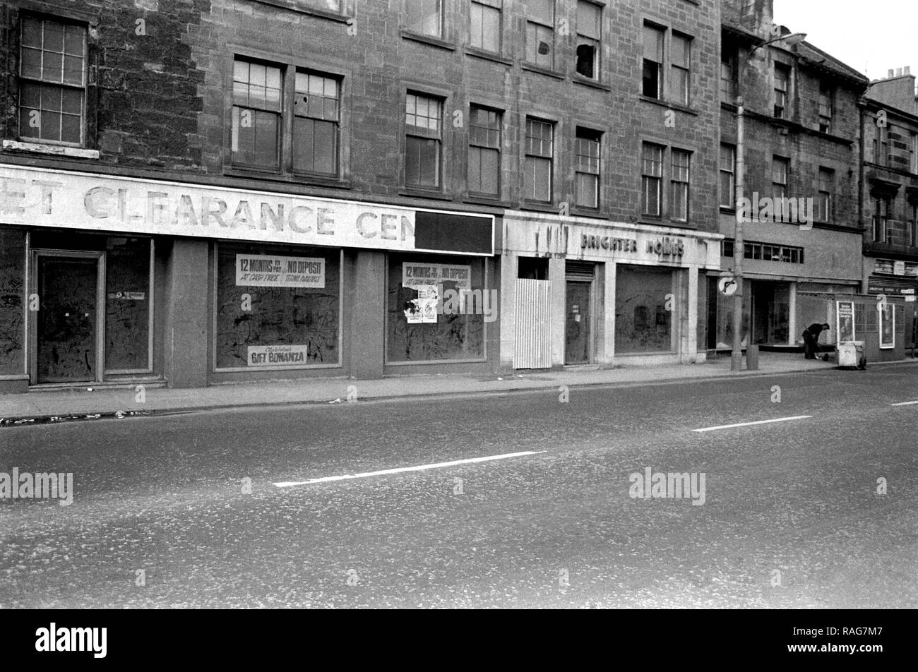 Shops and Tenements on Glasgow Road, Clydebank awaiting demolition to make way for the Clydeside Expressway. 1979 Stock Photo
