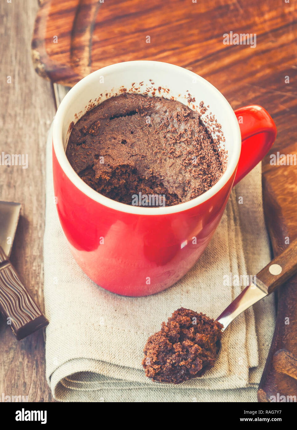 Chocolate cake in a mug. Vintage toned picture. - Stock Image
