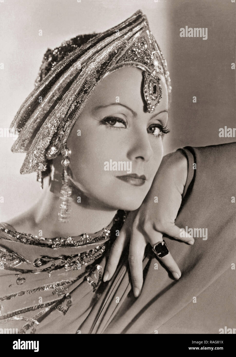 Greta Garbo, 1905-1990.  Swedish born actress who later took American citizenship.  This photograph shows her in costume for the 1931 Metro-Goldwyn-Mayer production of Mata Hari. - Stock Image