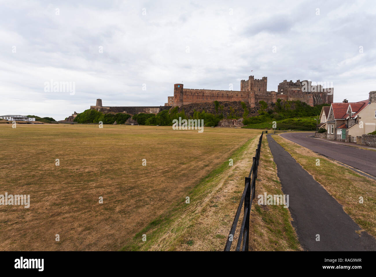 The approach road to Bamburgh Castle in Northumberland,England,UK - Stock Image