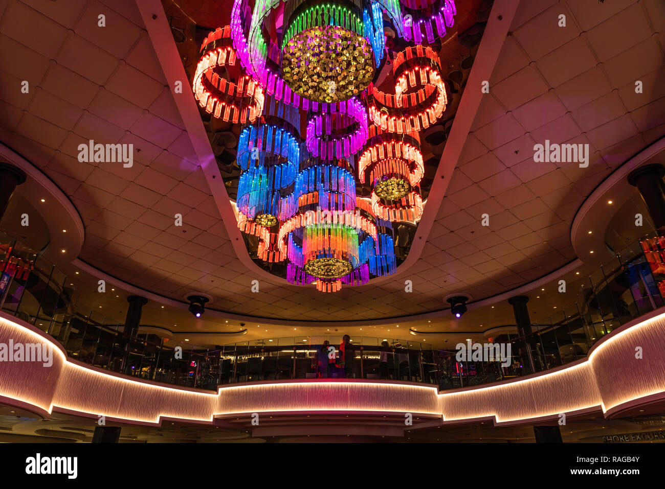 A large colorful light fixture in the atrium of the cruise ship Norwegian Jade. - Stock Image