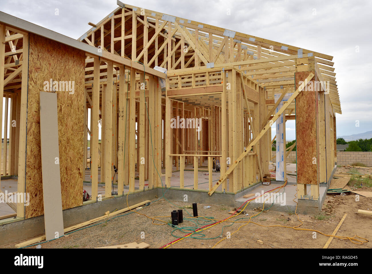 New wood frame house construction in USA, development of residential suburban site - Stock Image