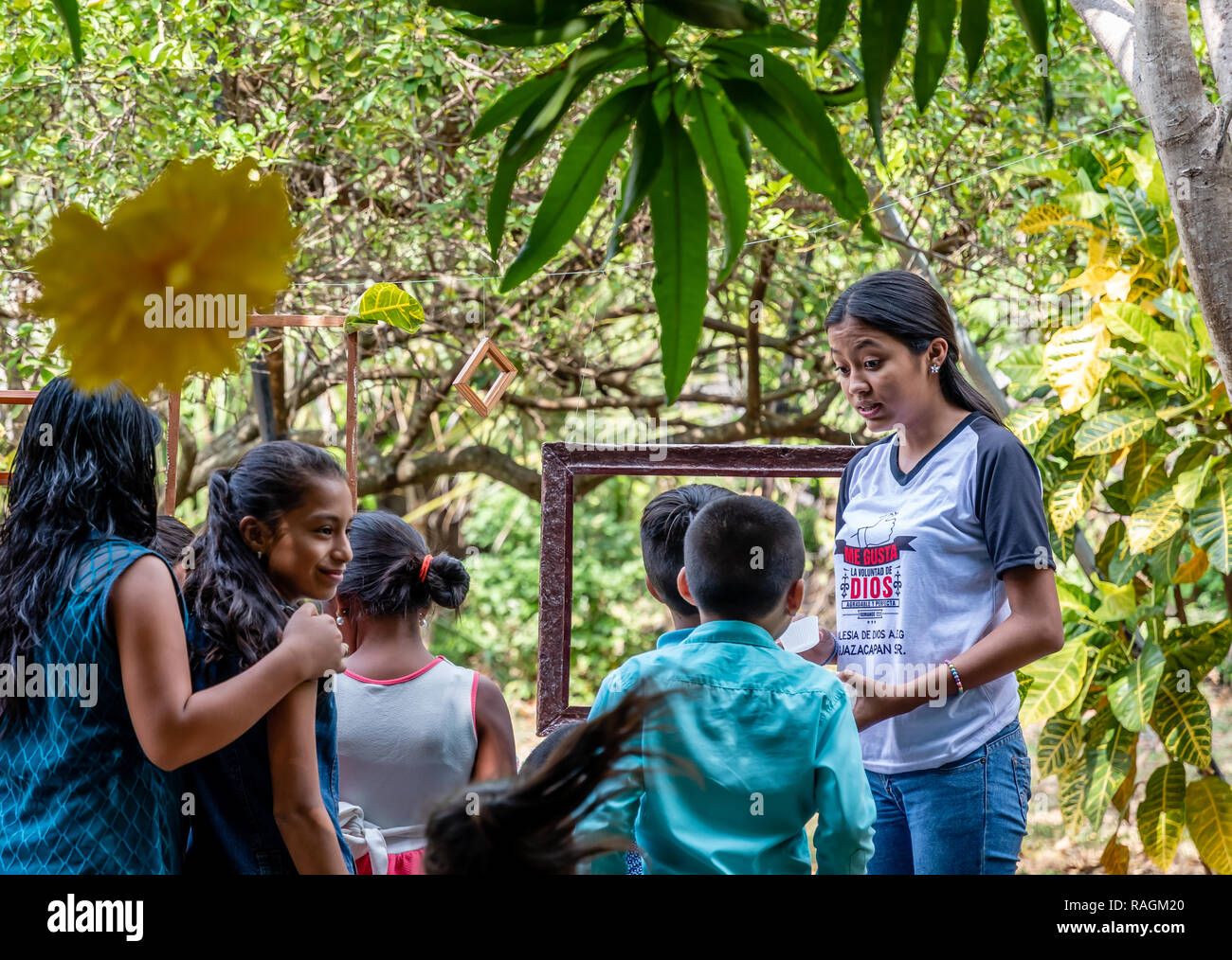 group of latin children looking at something at party in Guatemala - Stock Image