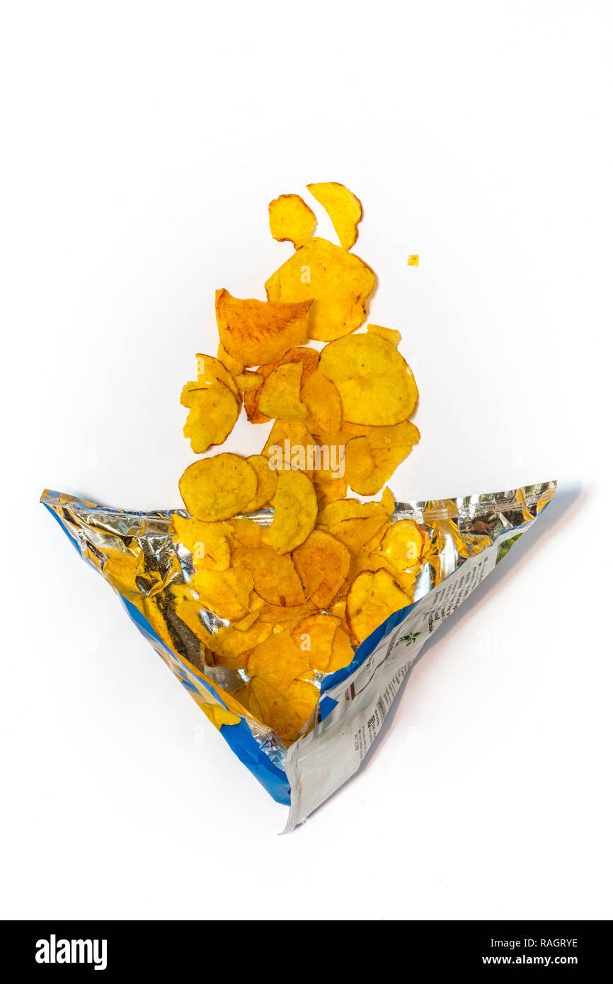 Opened crisp packet showing crisps in an unrecyclable packet.– - Stock Image