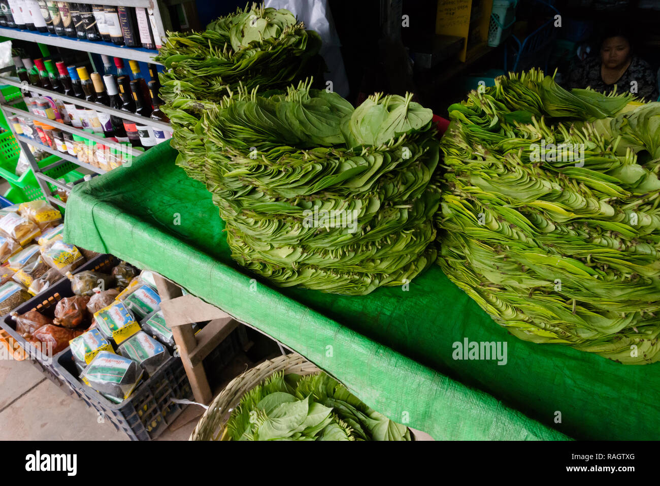 Betel nut leaves arranged into circles, for sale at a stall