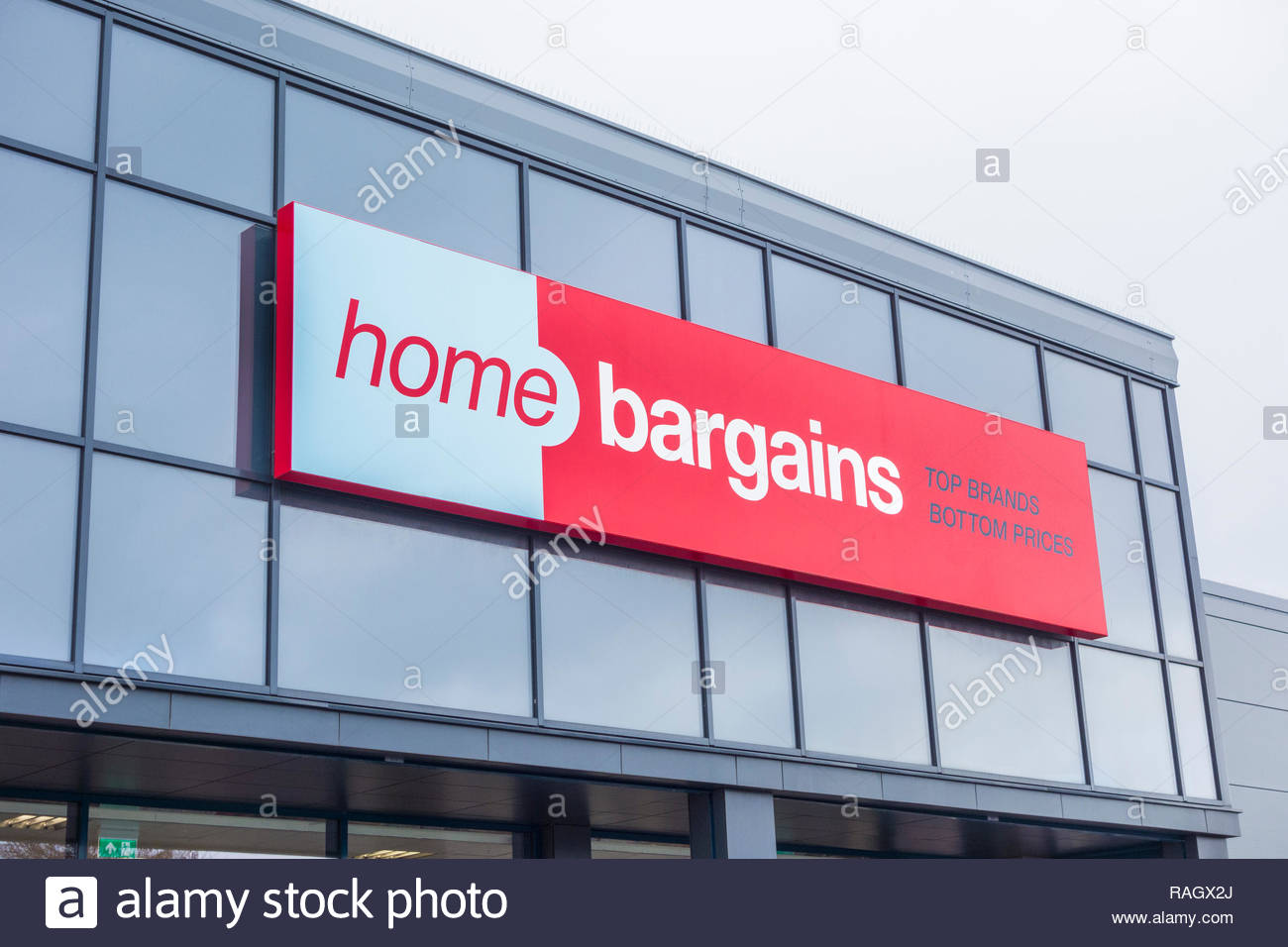 Sign on Home Bargains store in Westgate, Morecambe, Lancashire, England, UK, offering Top Brands at Bottom Prices - Stock Image