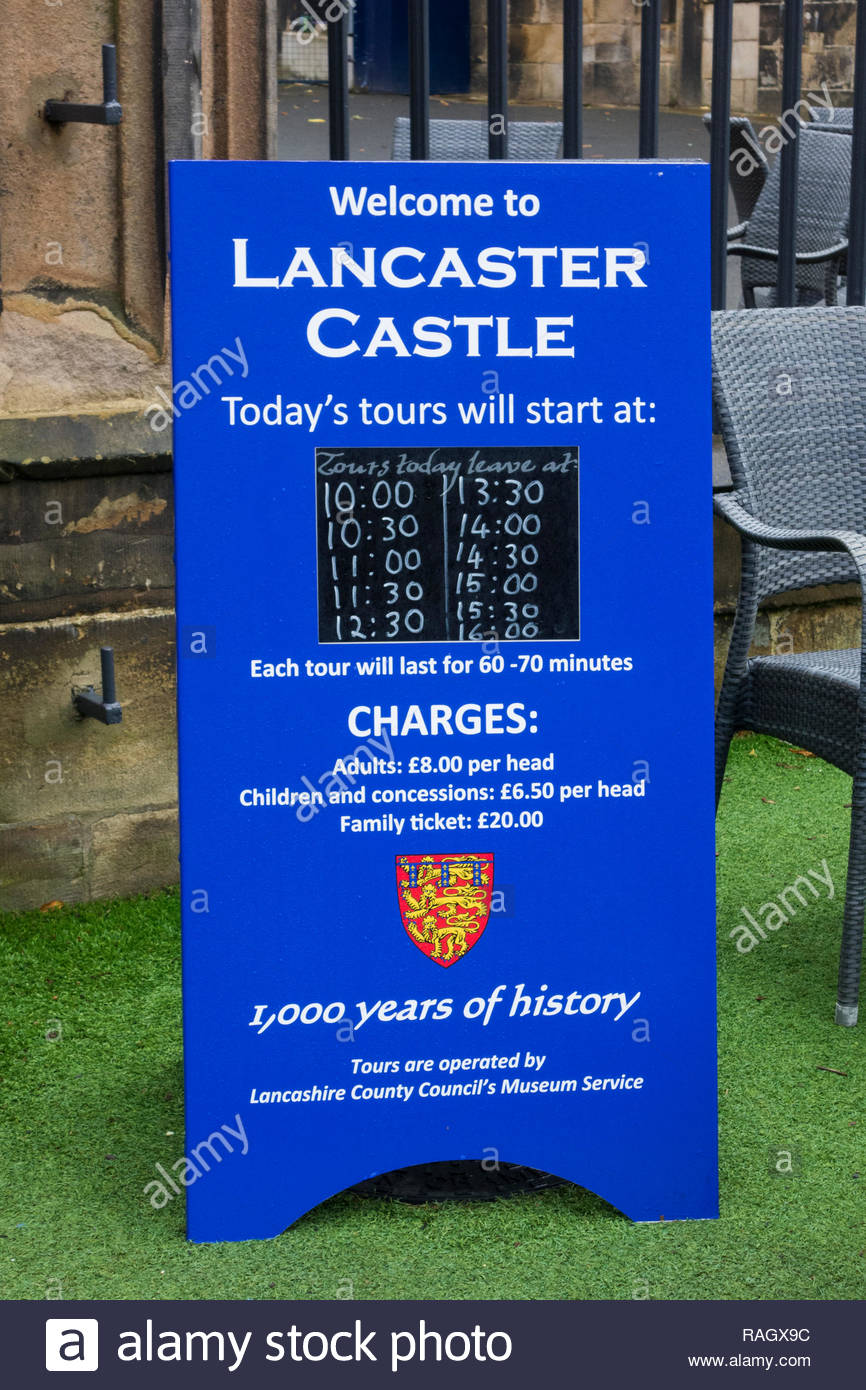 Notice board advertising times and charges (prices) for tours around Lancaster Castle in Lancaster, Lancashire, England, UK Stock Photo