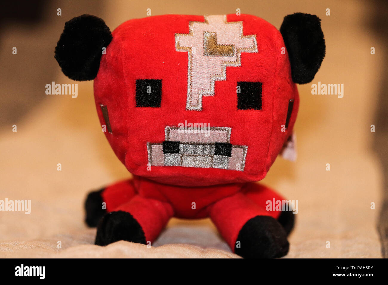 Minecraft red cow plush - Stock Image