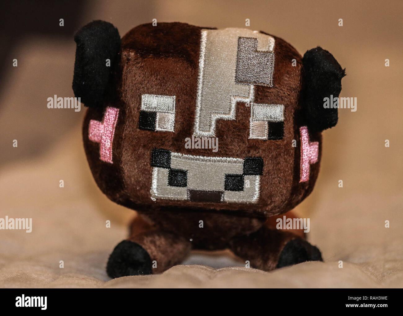Minecraft brown cow plush - Stock Image