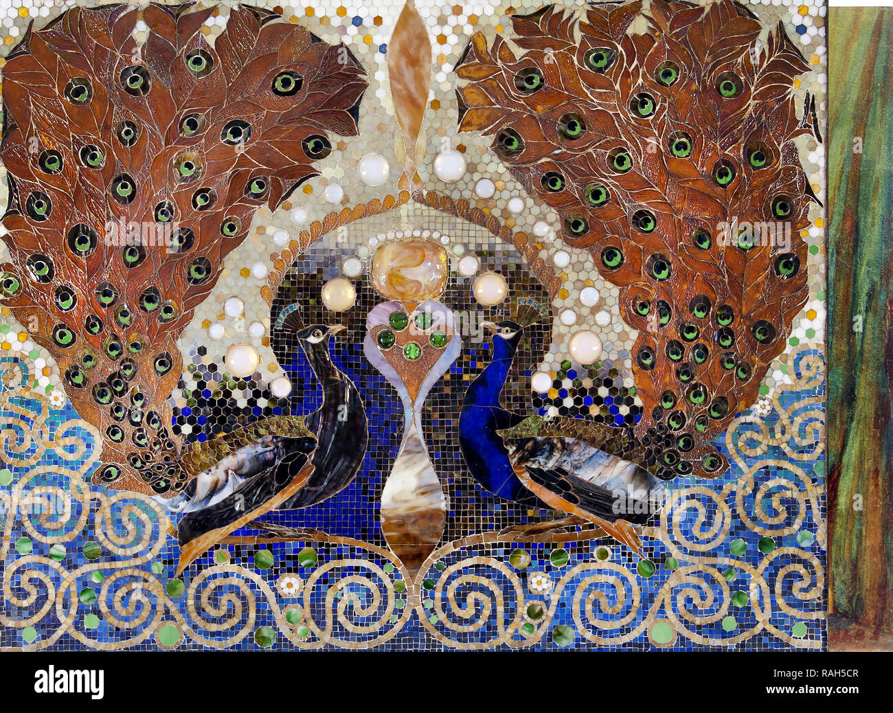 Louis Comfort Tiffany, Peacock Mosaic from Entrance Hall of the Henry O. Havemeyer House, New York 1890-1891 Favrile glass, pottery, and plaster, University of Michigan Museum of Art. - Stock Image