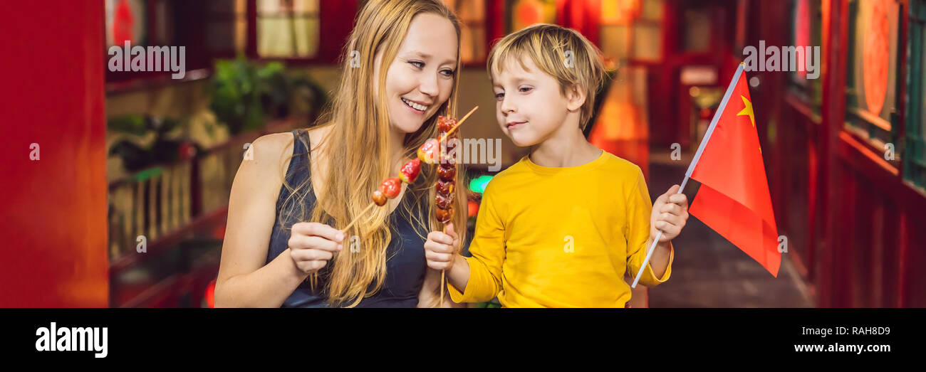 Enjoying vacation in China  Happy tourists mom and son with