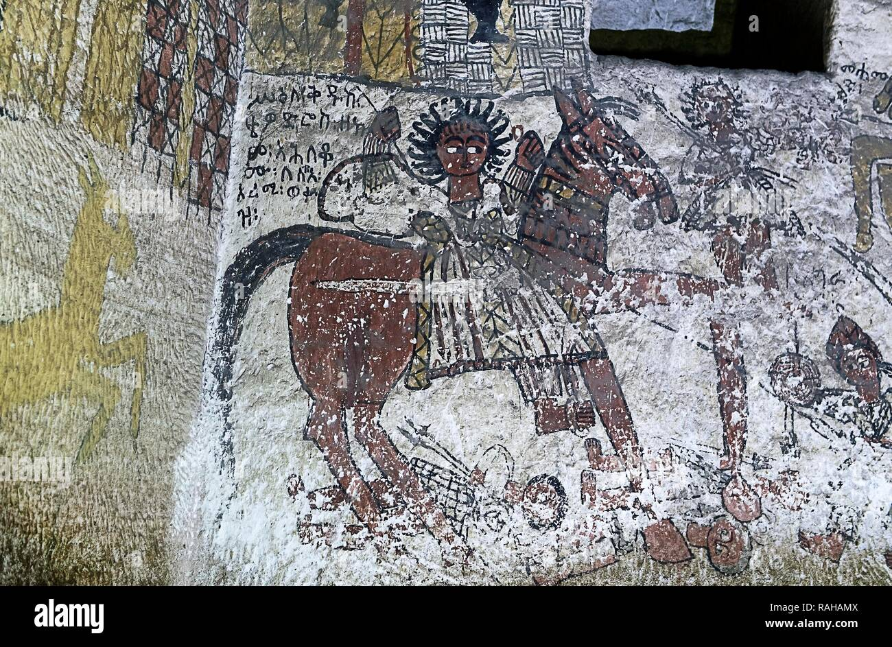 Saint Theodor of the Romans riding a horse kills the Muslim enemies of the Christians, fresco in the rock church Yohannes - Stock Image