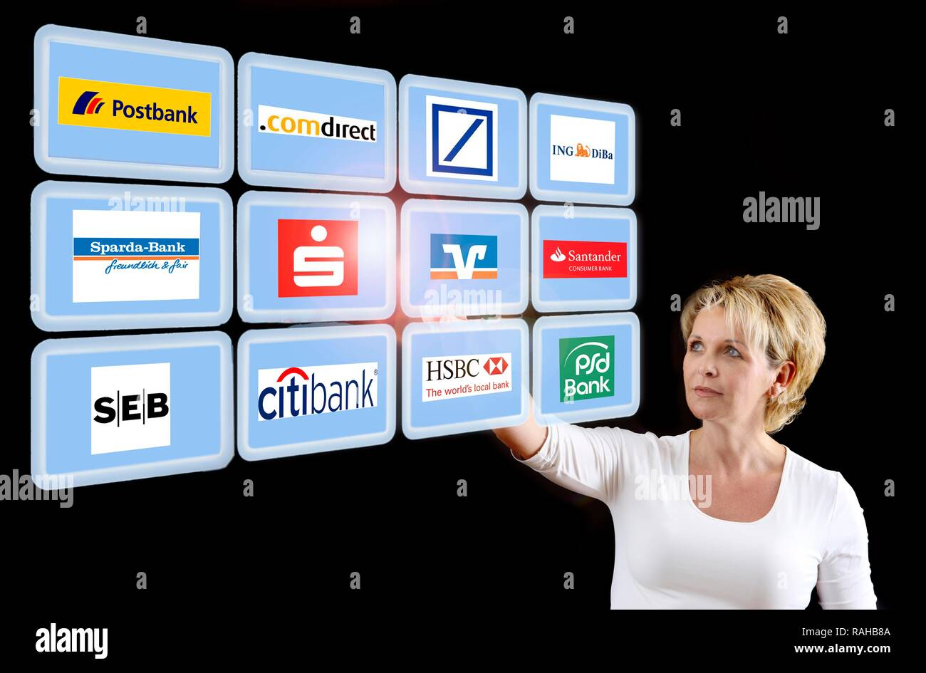 Woman working with a virtual screen, touch screens, banks, financial institutions Stock Photo