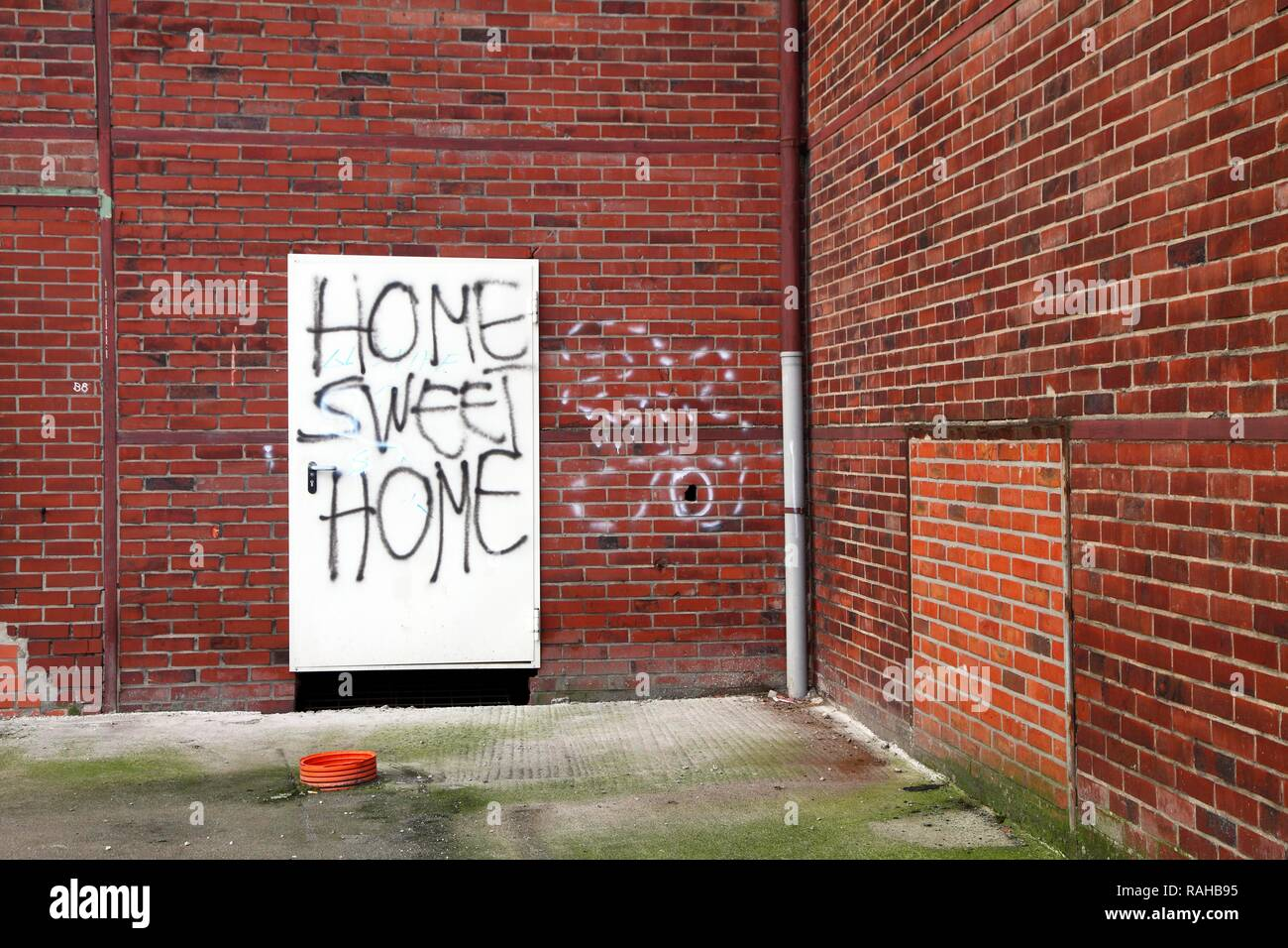 Graffiti, Home Sweet Home, on the door of a building to be demolished, old factory hall, Herten, North Rhine-Westphalia - Stock Image