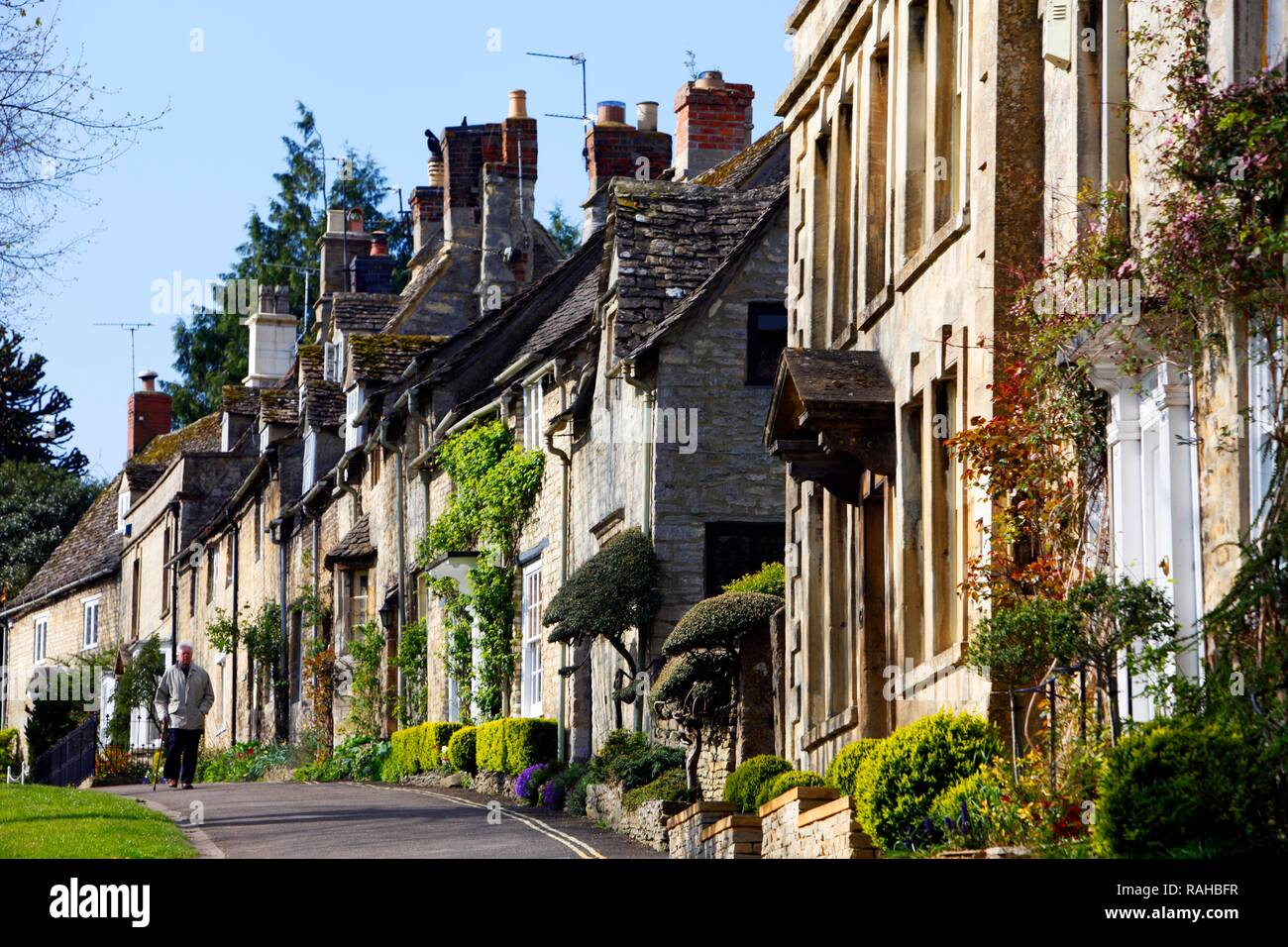 Row of old stone houses on High Street, Burford, Oxfordshire, United Kingdom, Europe - Stock Image