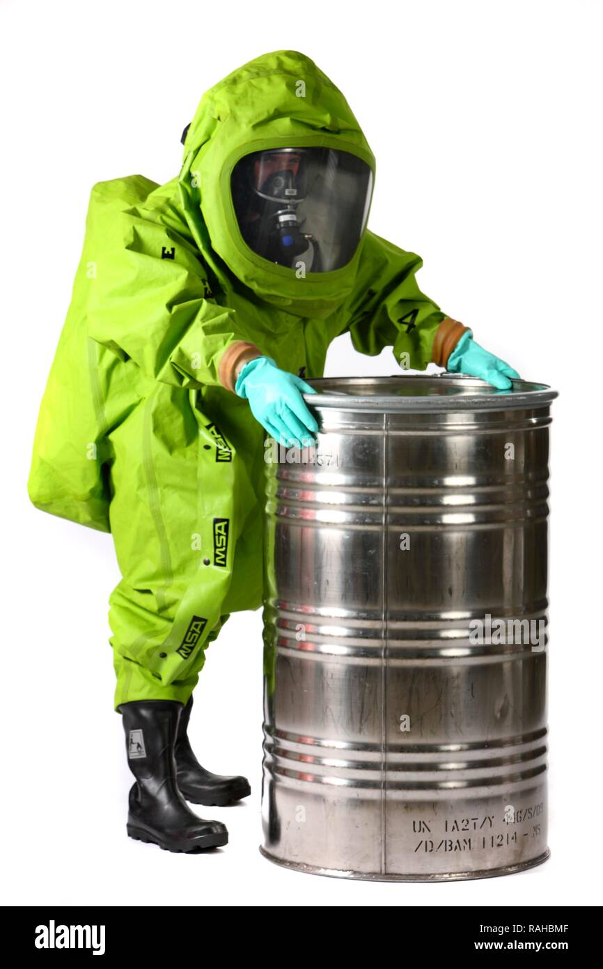 Firefighter Wearing A Chemical Protective Suit With Air Supply From Compressed Breathing Apparatus Professional