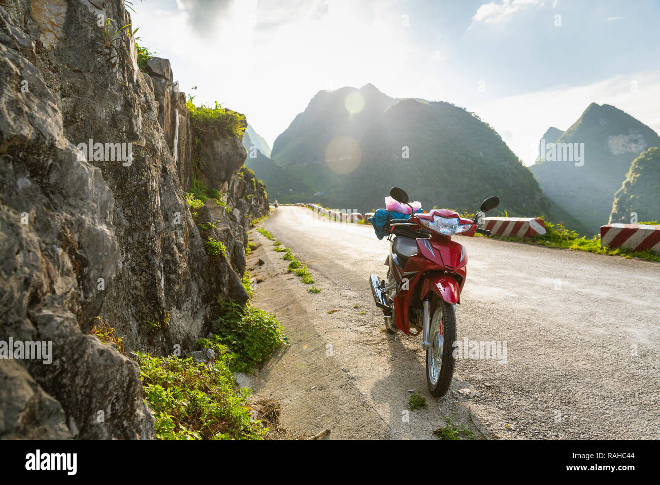 Red motorbike parked on the side of the road, off the Ha Giang Loop, Ha Giang Province, Vietnam, Asia Stock Photo