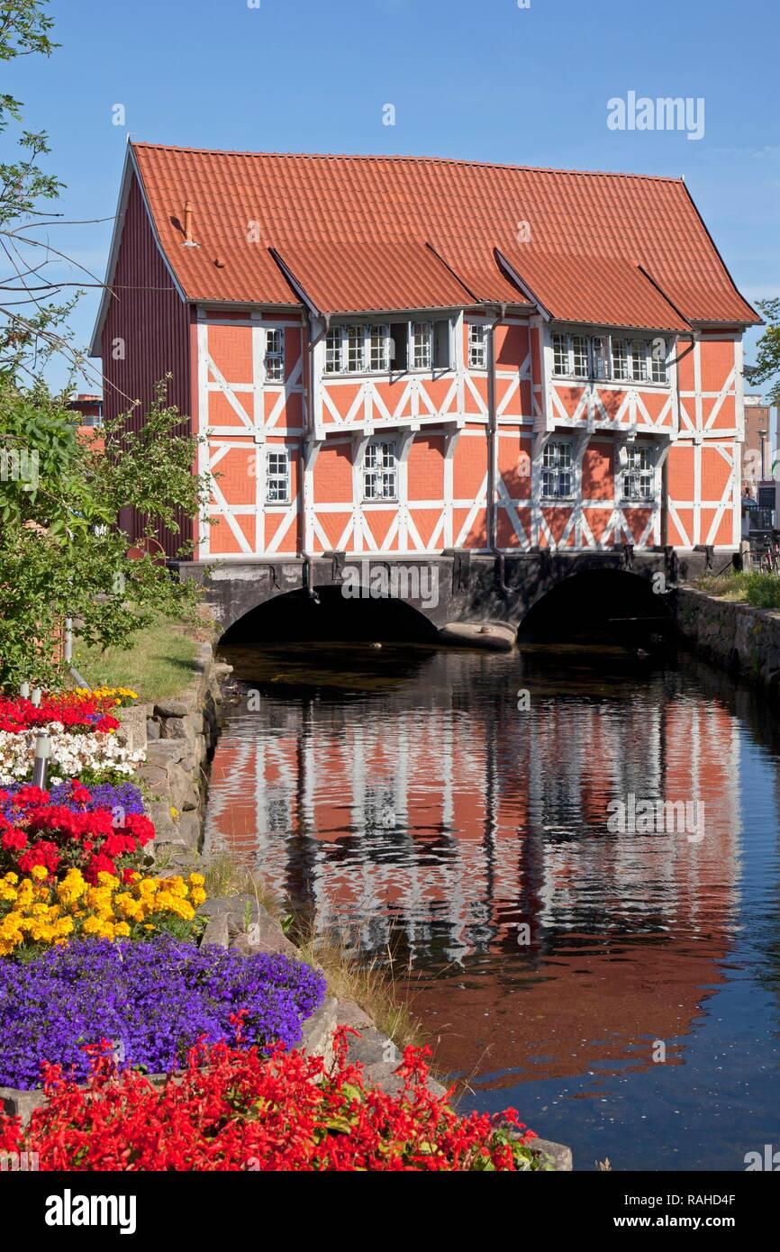 Half-timbered building 'Gewoelbe' above the regulated 'Grube' creek, Wismar, Mecklenburg-Western Pomerania - Stock Image