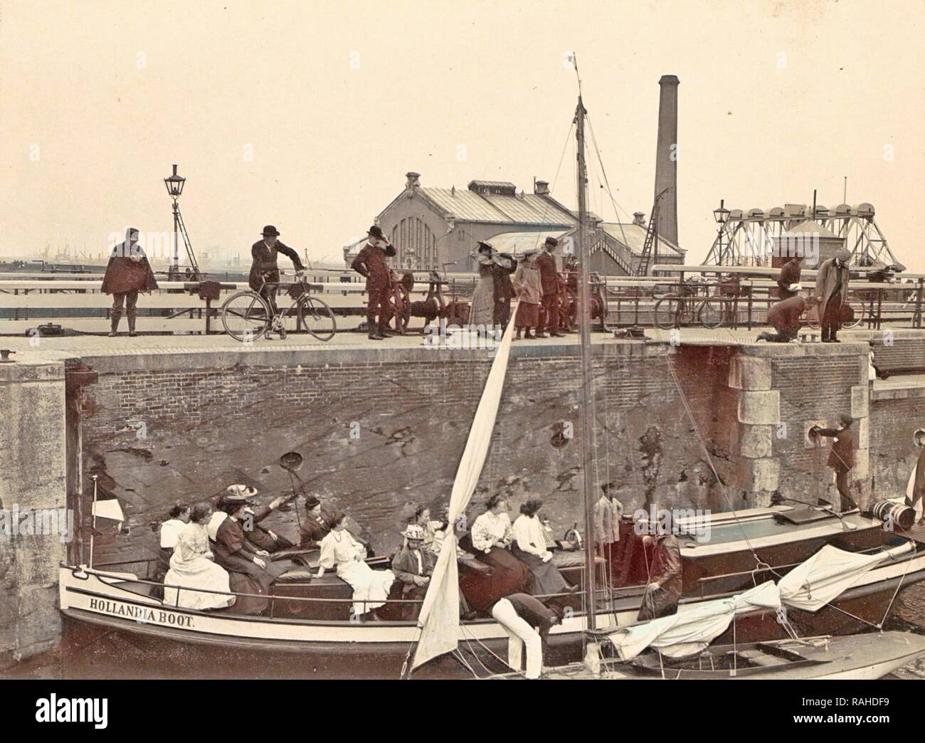 Onlookers view the locking of the Hollandia boat Oranjesluizen Amsterdam, The Netherlands, Anonymous, c. 1900 - c reimagined Stock Photo