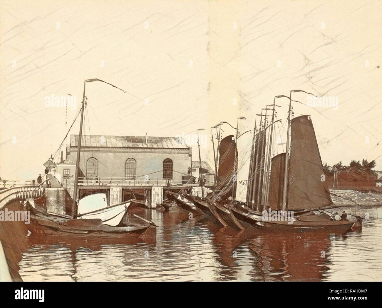 Moored sailing vessels in the Oranjesluizen in Amsterdam, The Netherlands, Anonymous, c. 1900 - c. 1910. Reimagined - Stock Image