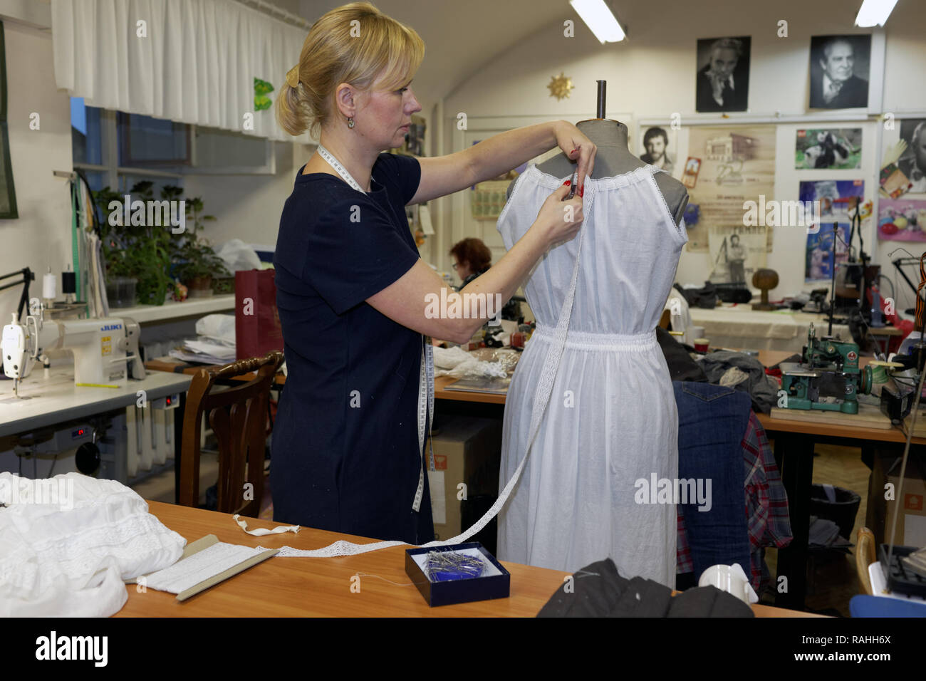 St. Petersburg, Russia - October 26, 2016: Unidentified apparel cutter at work in the Alexandrinsky theater. The theater was created in 1756 by the or Stock Photo