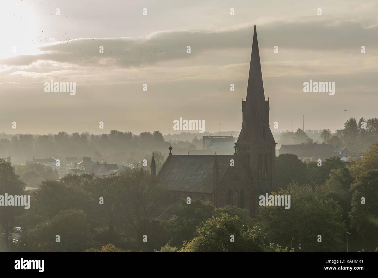 All Saints Church in Runcorn at day break, sun rise taken from the Silver Jubilee Bridge - Stock Image