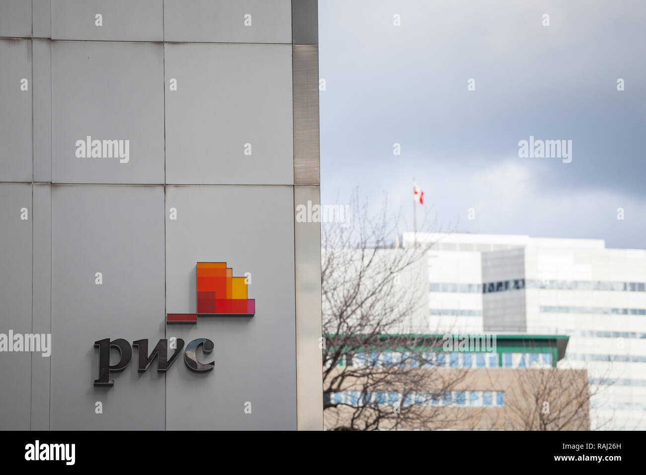 MONTREAL, CANADA - NOVEMBER 7, 2018: PWC logo on their main office for Quebec in Montreal, in a business district. PriceWaterHouseCoopers is one of  m - Stock Image