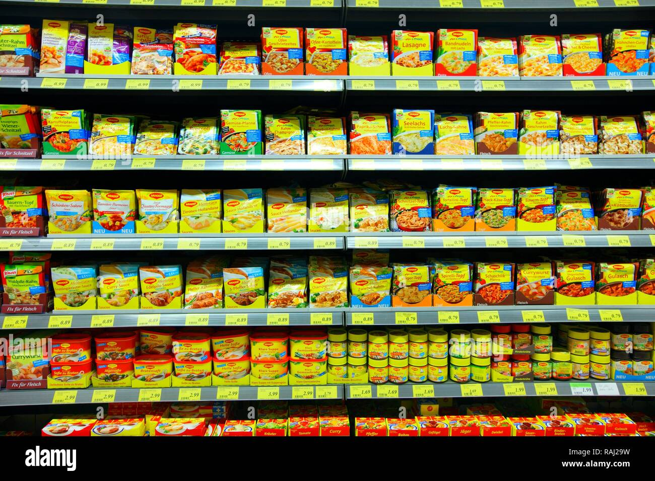 Shelves with packet soups, convenience foods, condiments, self-service, food department, supermarket - Stock Image