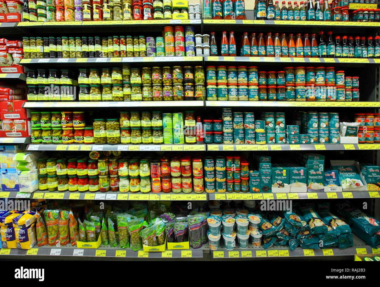 Shelves with foreign specialties, food, self-service, food department, supermarket - Stock Image