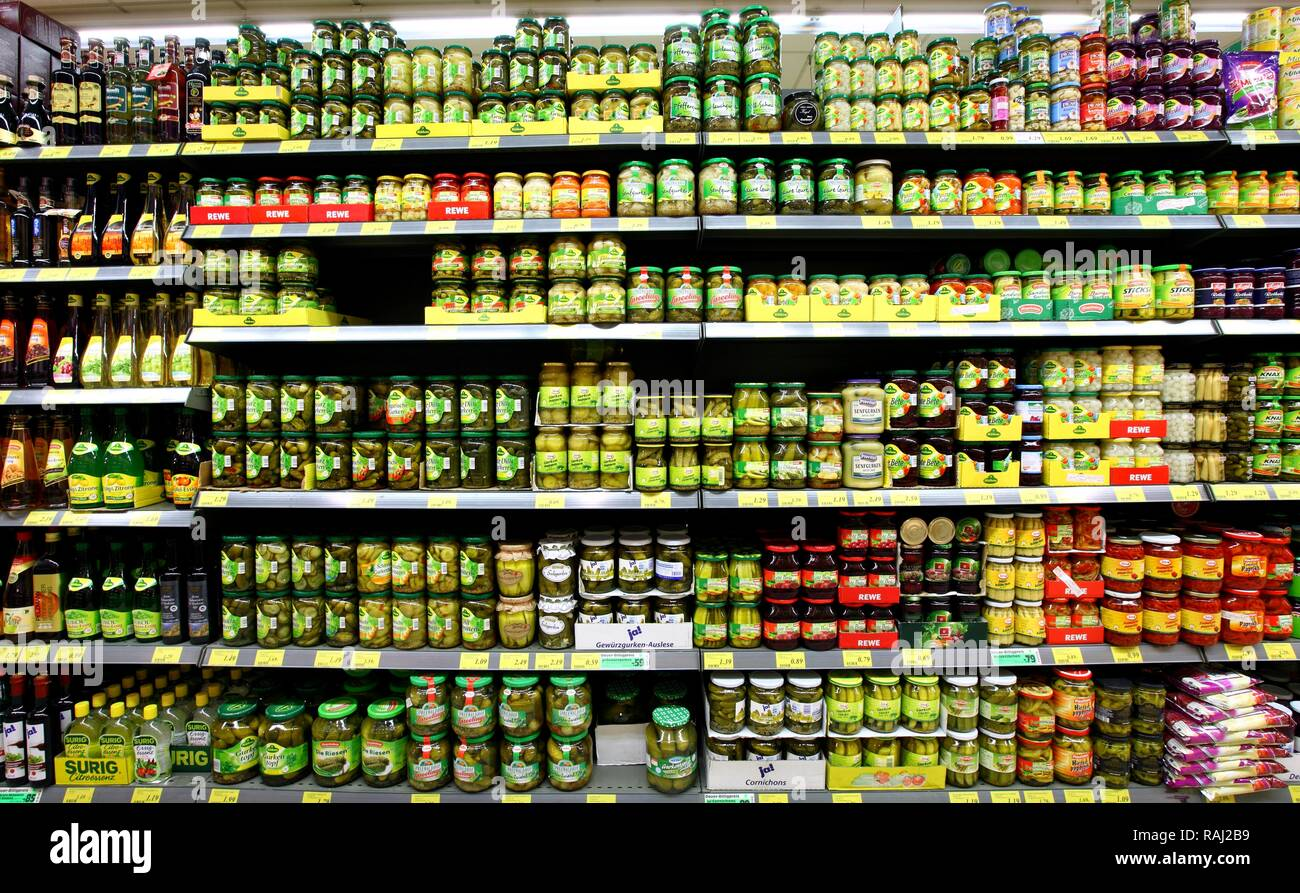 Shelves with pickled vegetables, pickles, self-service, food department, supermarket - Stock Image