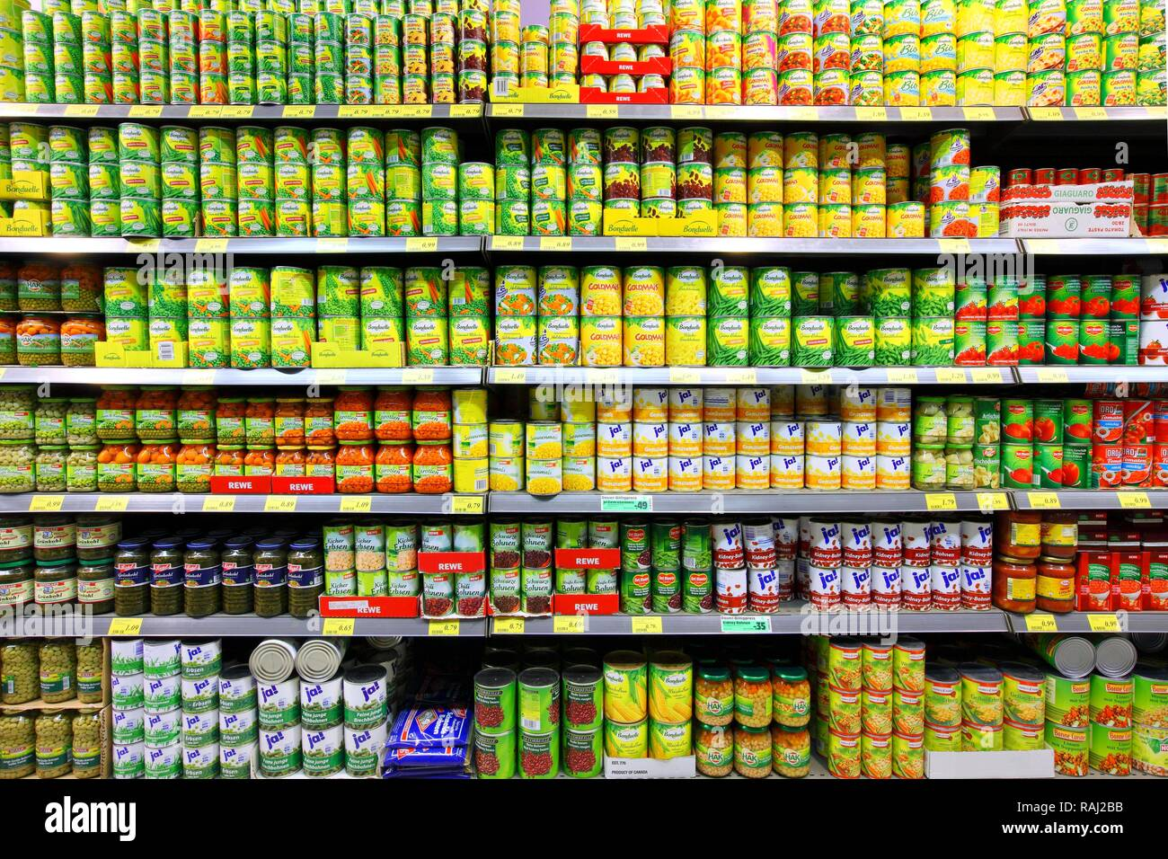 Shelves with canned food, self-service, food department, supermarket - Stock Image