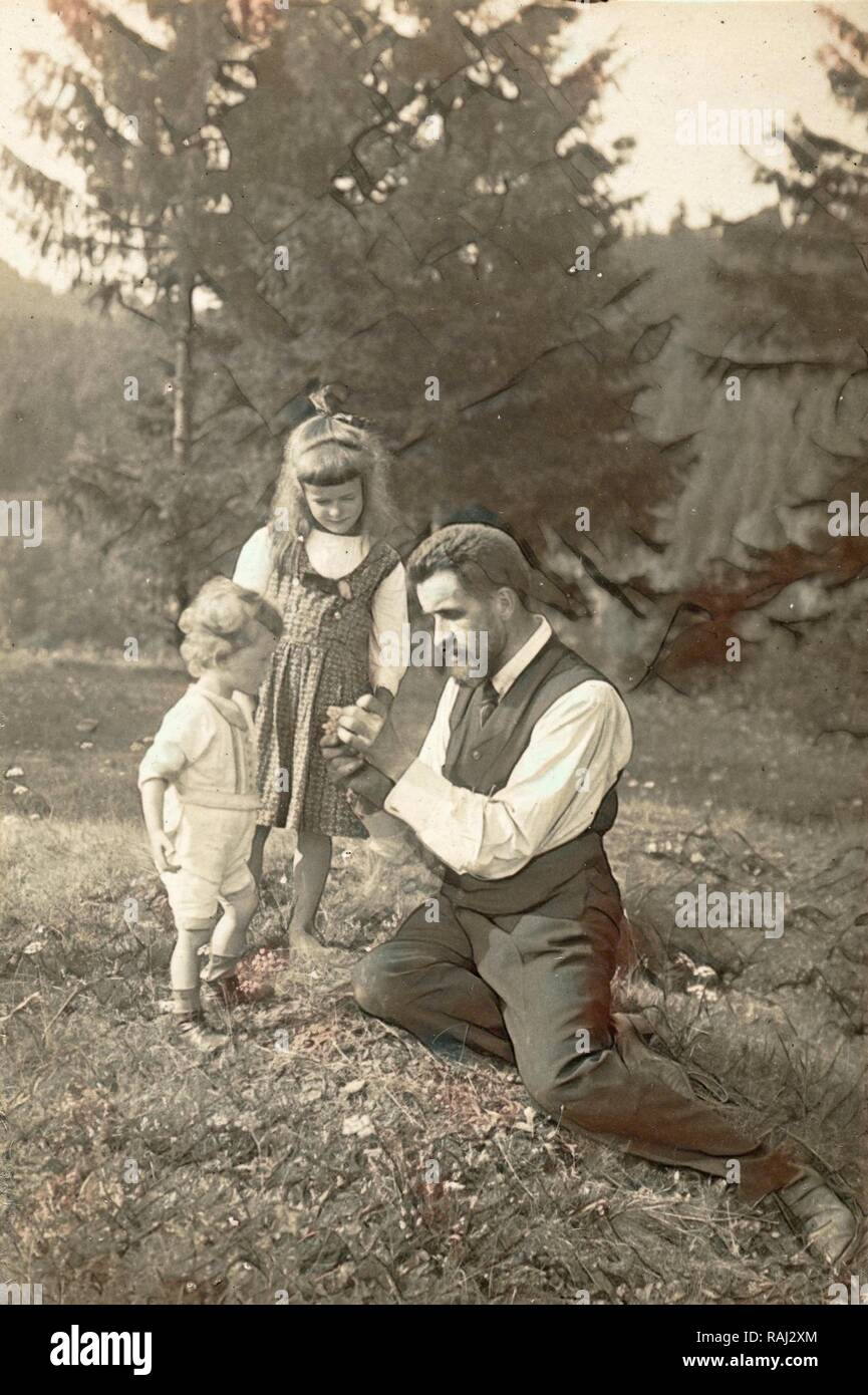 Waldemar Titzenthaler, the photographer, with his children and Marba Eckart in a clearing, Waldemar Titzenthaler reimagined - Stock Image